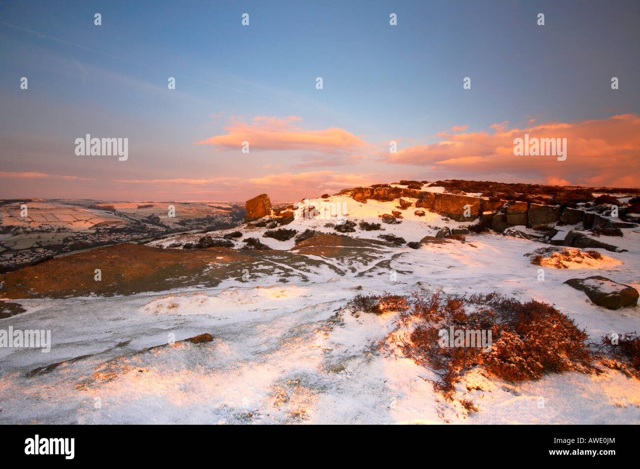 Winter scene at sunrise on a snow covered Curbar edge in Derbyshire Peak District Stock Photo