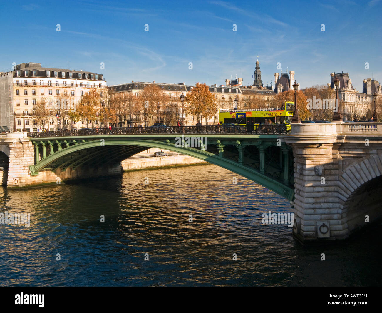 Tourist bus crosses the Pont Notre Dame over the Seine in Paris France Europe - Stock Image