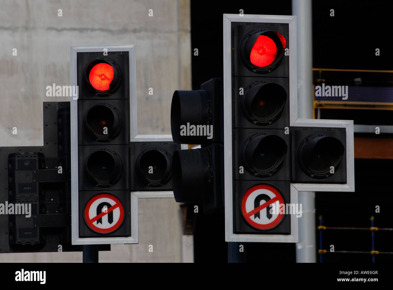 two red stop sign traffic lights - Stock Image