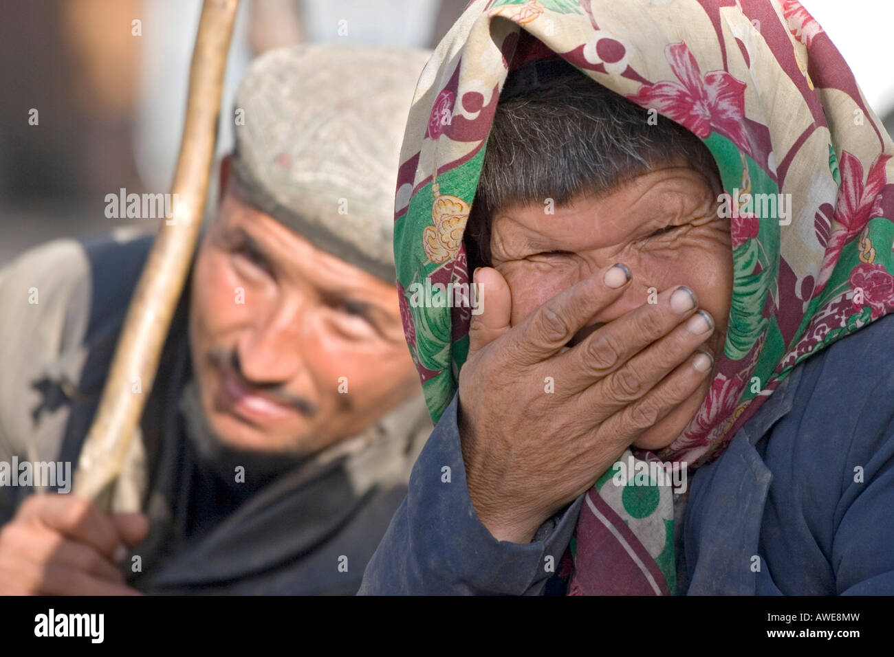 Asia, china, portrait of an od chinese woman, in the backround a chinese man. - Stock Image