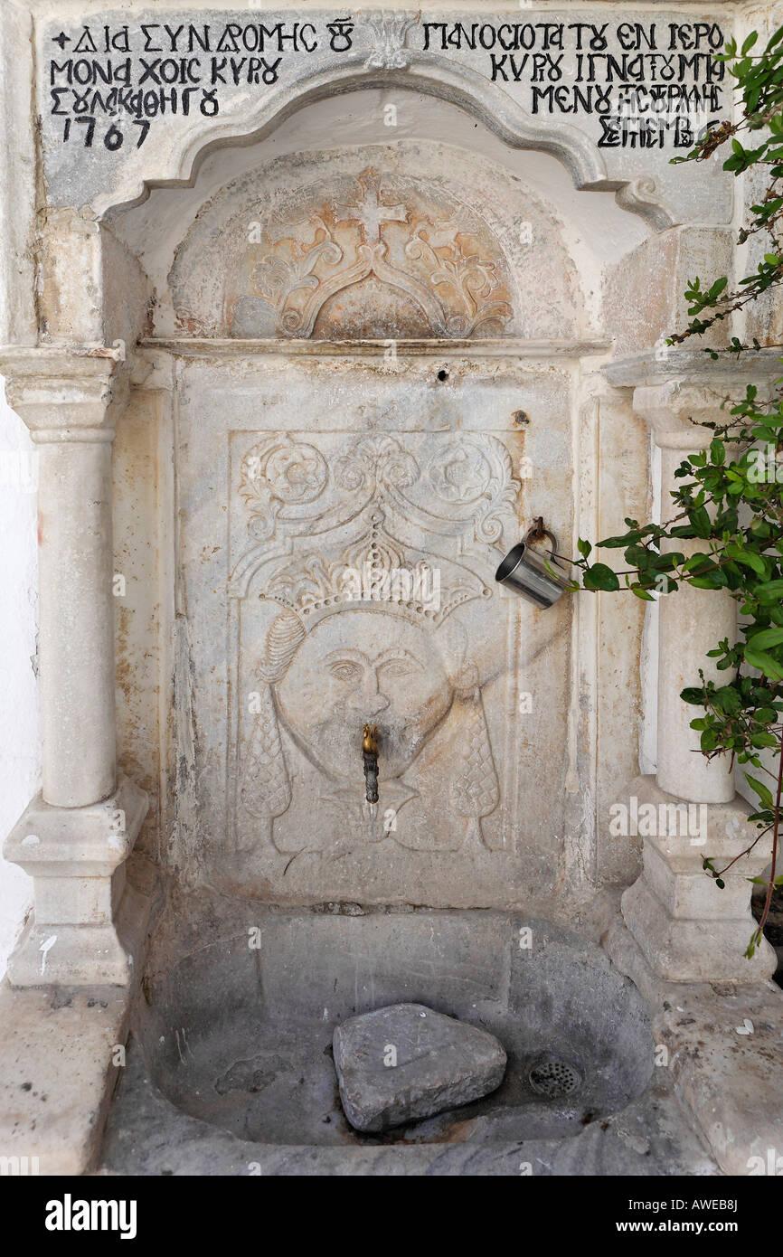 Old well at the Panajia-Tourliani monastery, Ano Mera, Myconos, Greece - Stock Image