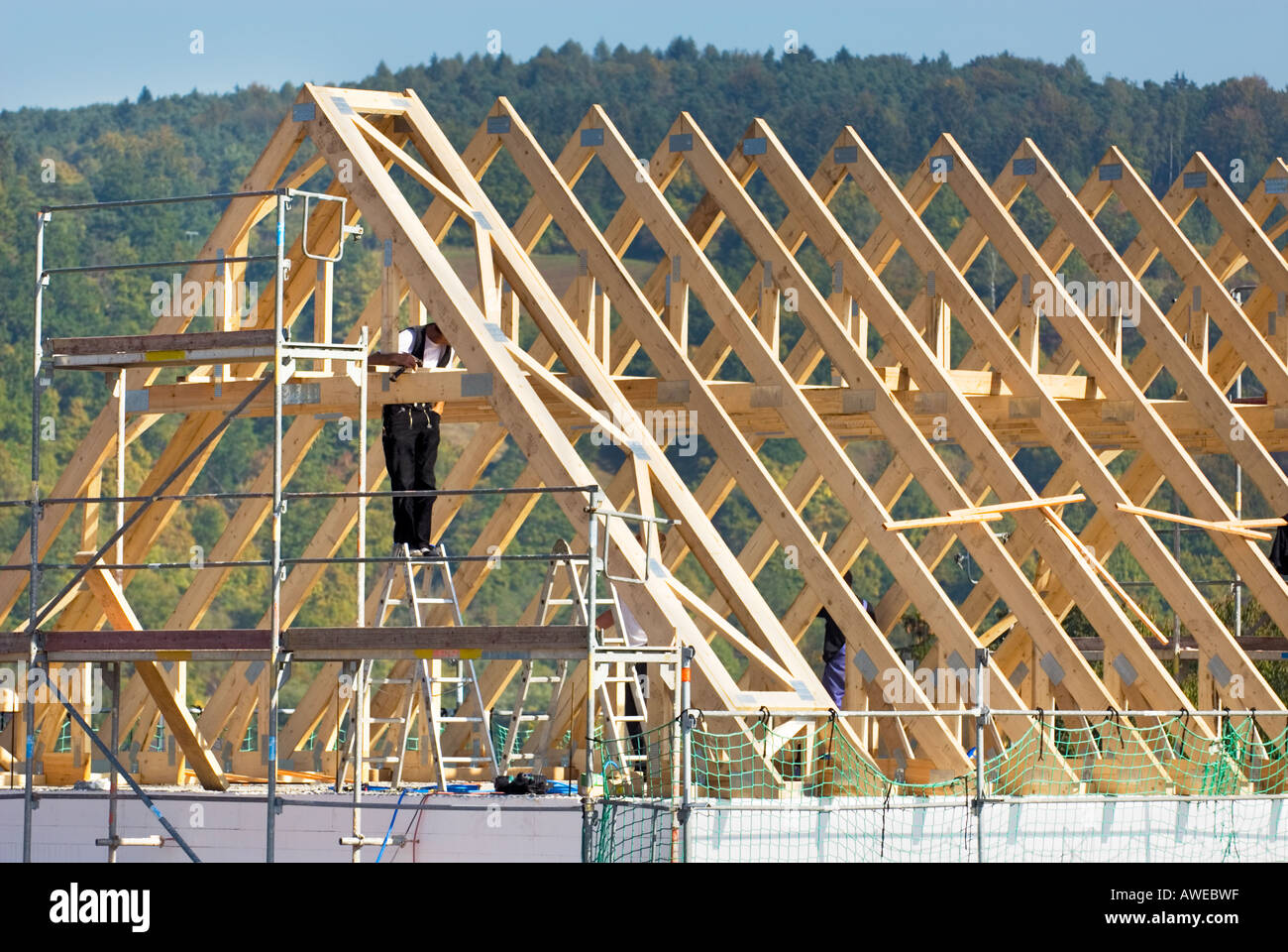 roof truss timbers Construction site brick wall cement gray