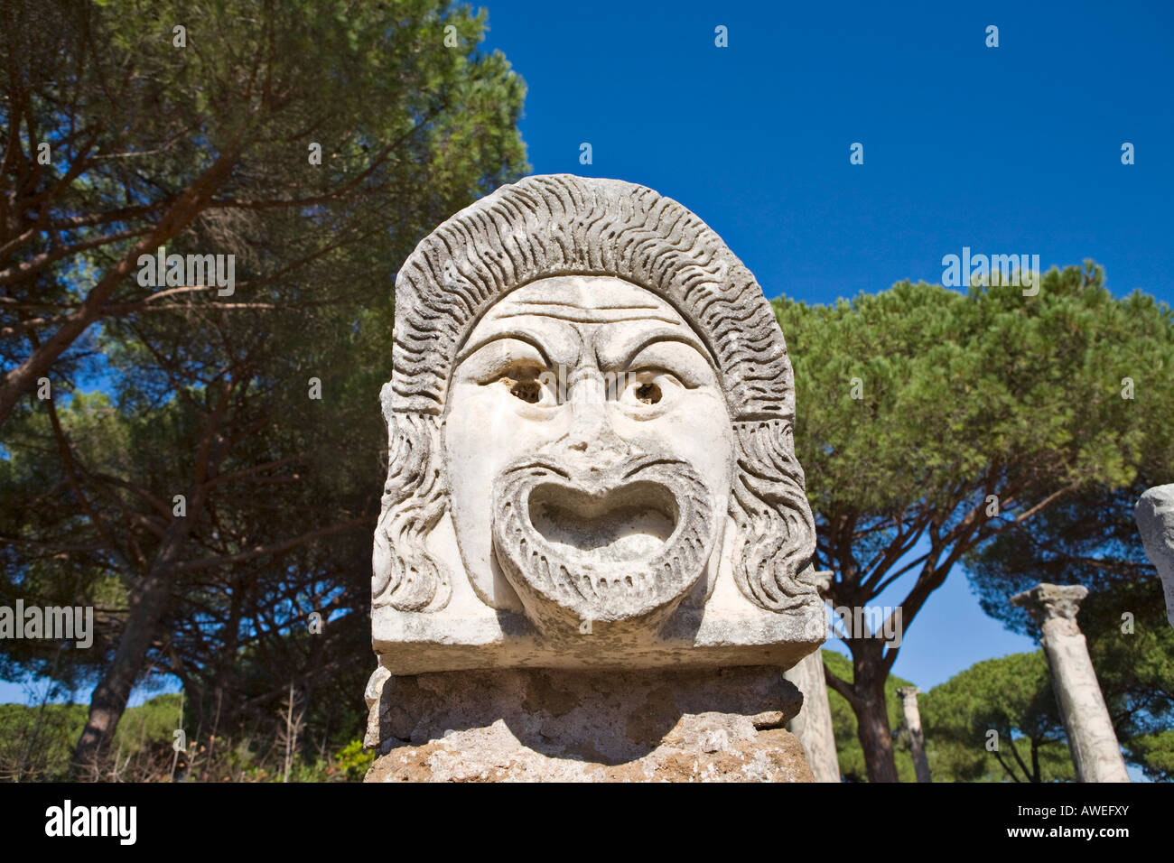 Comical masks at the amphitheatre at Ostia Antica archaeological site, Rome, Italy, Europe - Stock Image