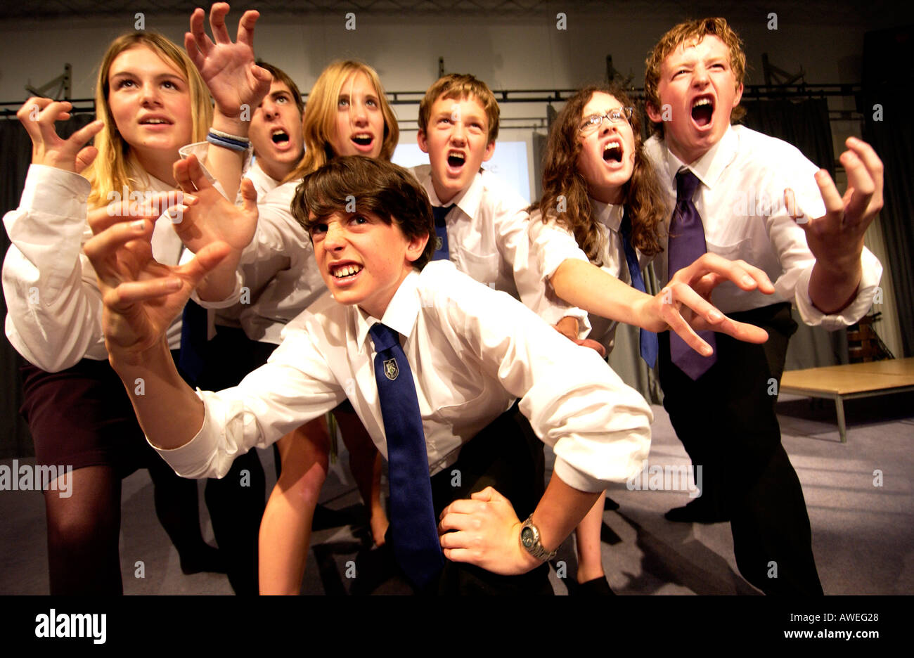 Teenagers in school uniforms in a drama class - Stock Image