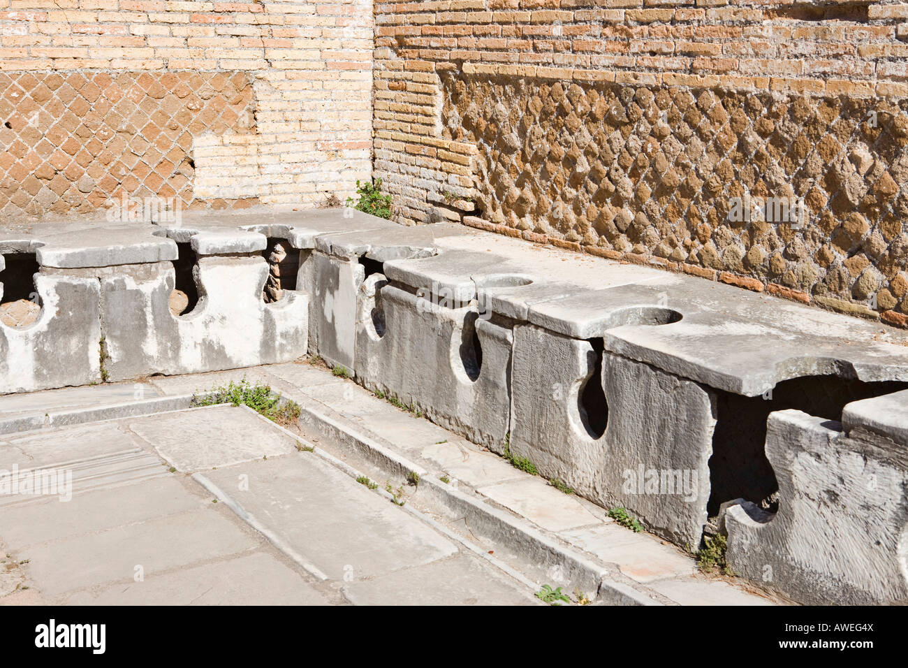 Ancient public toilets at Ostia Antica archaeological site ...