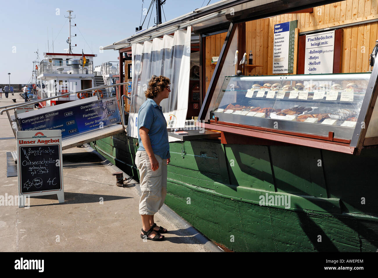 Seafood vendor and bistro on a boat, Sassnitz, Ruegen, Germany, Europe Stock Photo