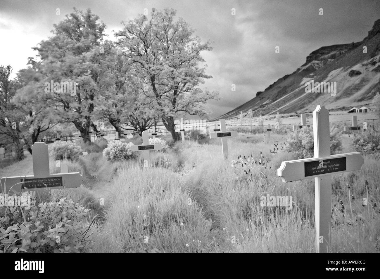 Cemetery at an old heathen church ('Hof'), infrared shot, southern coast of Iceland, Atlantic Ocean - Stock Image