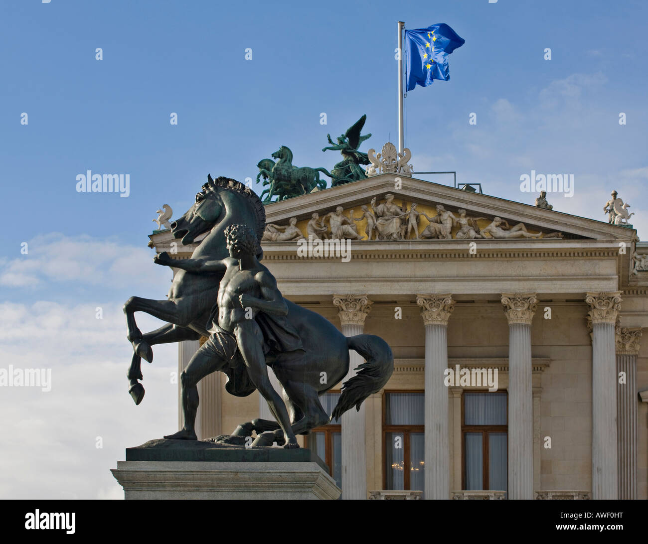 Rossebaendiger statue in front of the left wing of the parliament building, Vienna, Austria, Europe - Stock Image