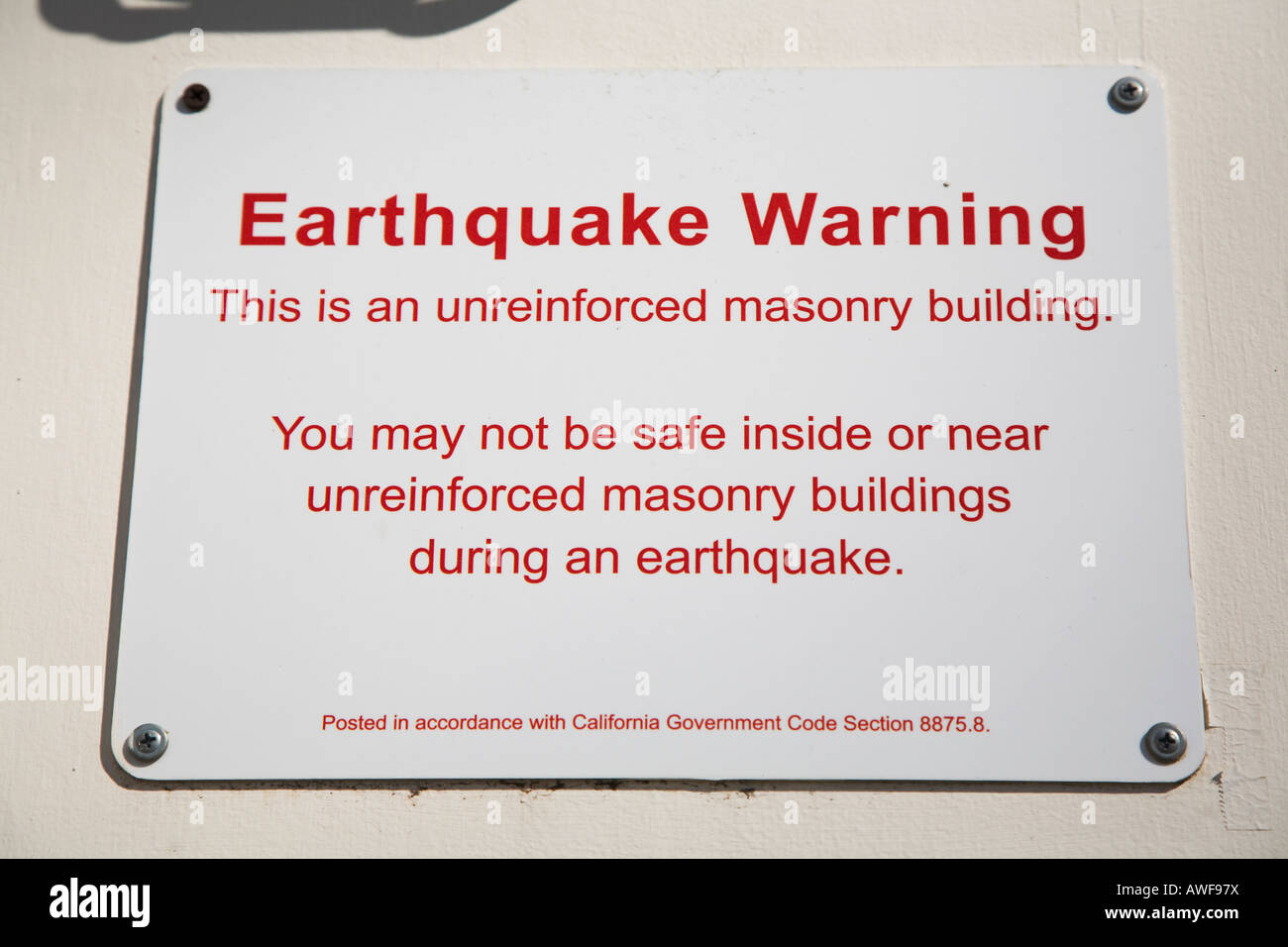 CALIFORNIA Santa Barbara Earthquake warning sign posted on unreinforced masonry building - Stock Image