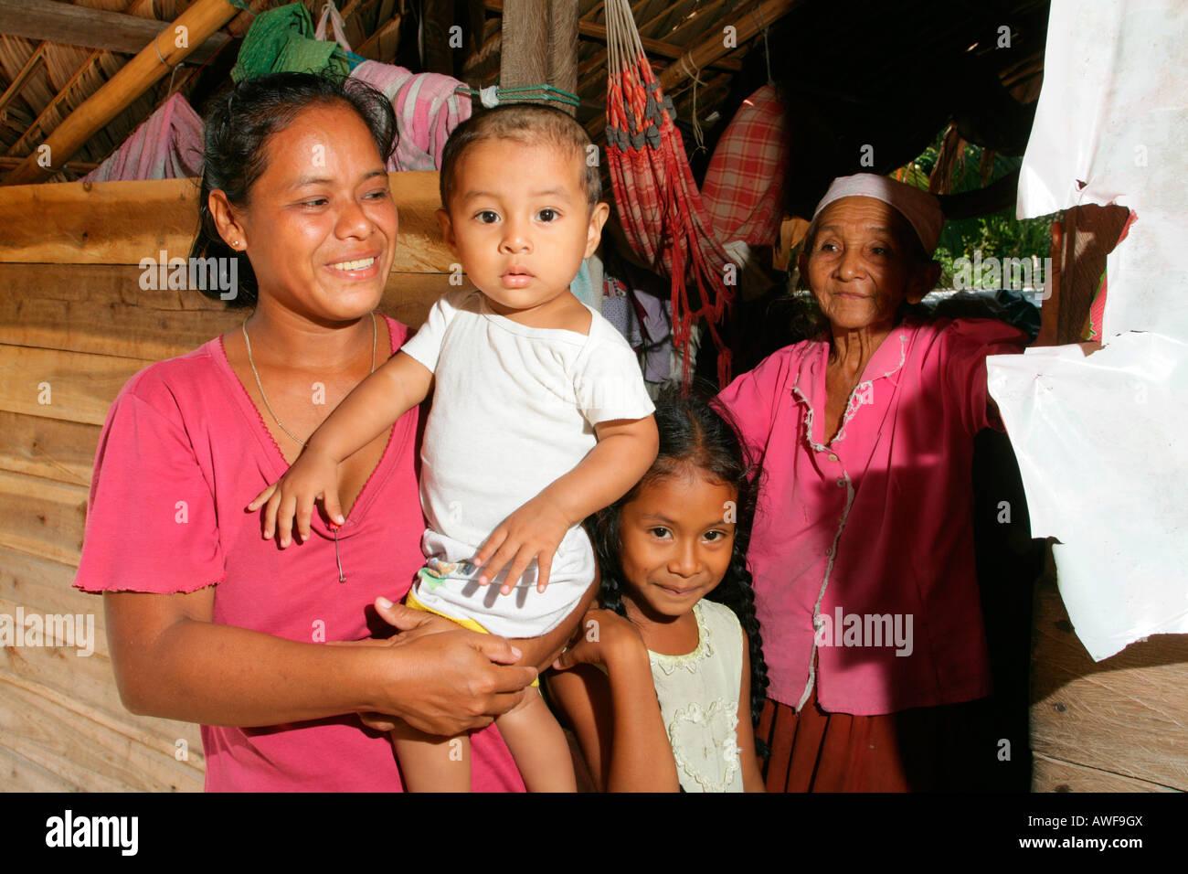 Three generations, Amerindians of the Arawak tribe, Santa Mission, Guyana, South America - Stock Image