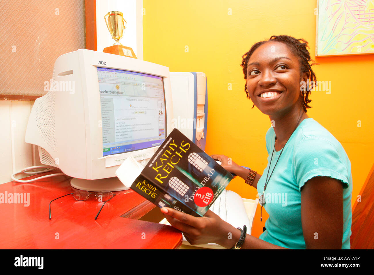 Student, young woman of African ethnicity working on computer, Georgetown, Guyana, South America - Stock Image