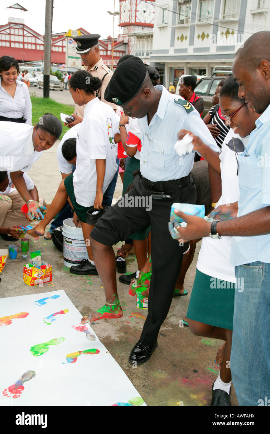 Colourful footprints to symbolize diverse ethnic backgrounds, protesting violence against women, in Georgetown, - Stock Image