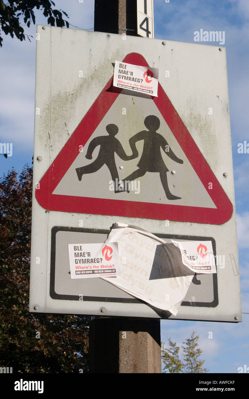 Road warning sign defaced by Welsh language protesters Roath Cardiff UK - Stock Image