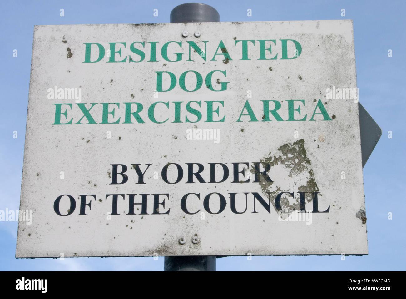 Designated dog walking area sign Water Meadows Abergavenny Gwent UK - Stock Image