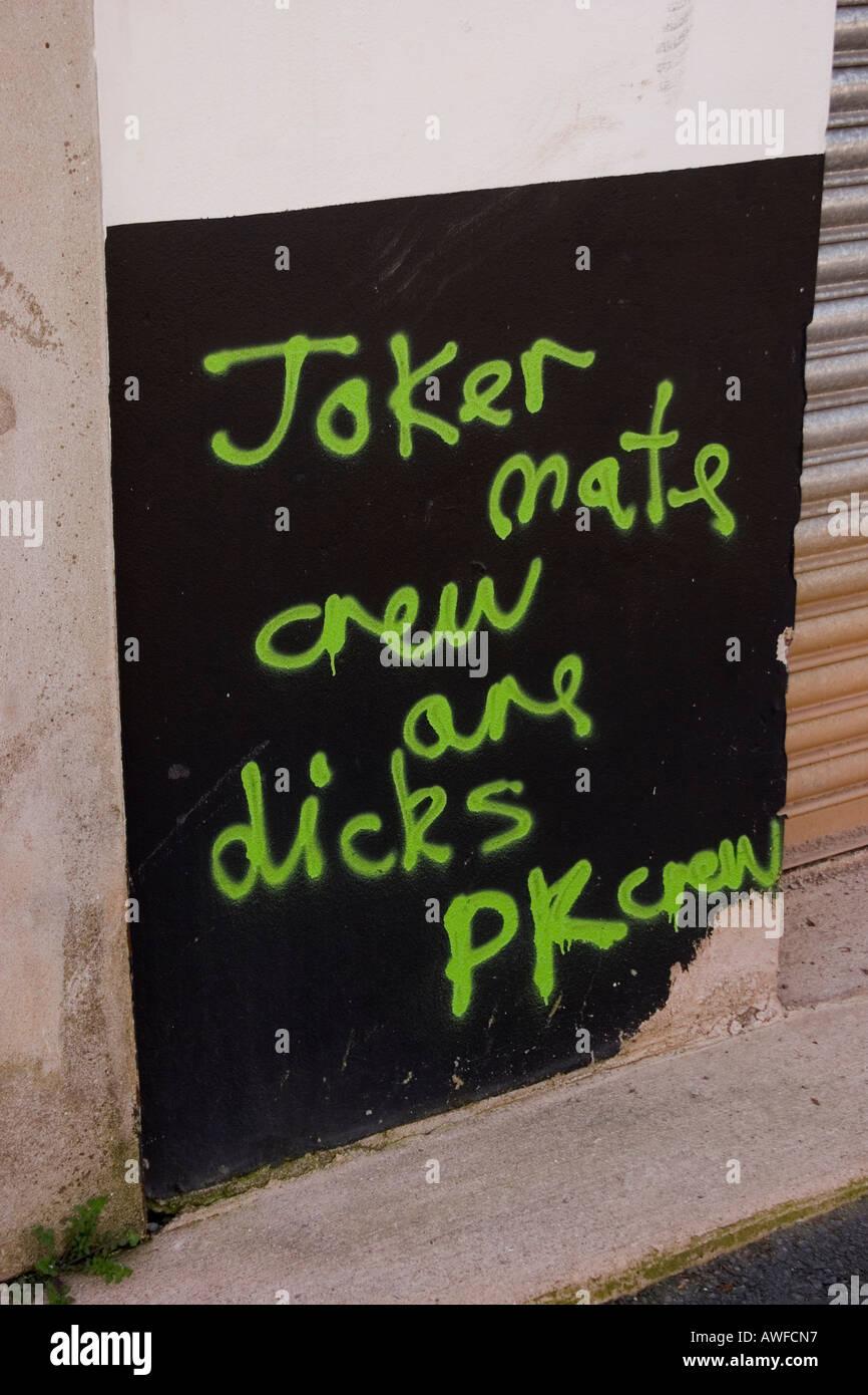 Dubious grammar in gang graffiti message on garage door post Roath Cardiff UK - Stock Image