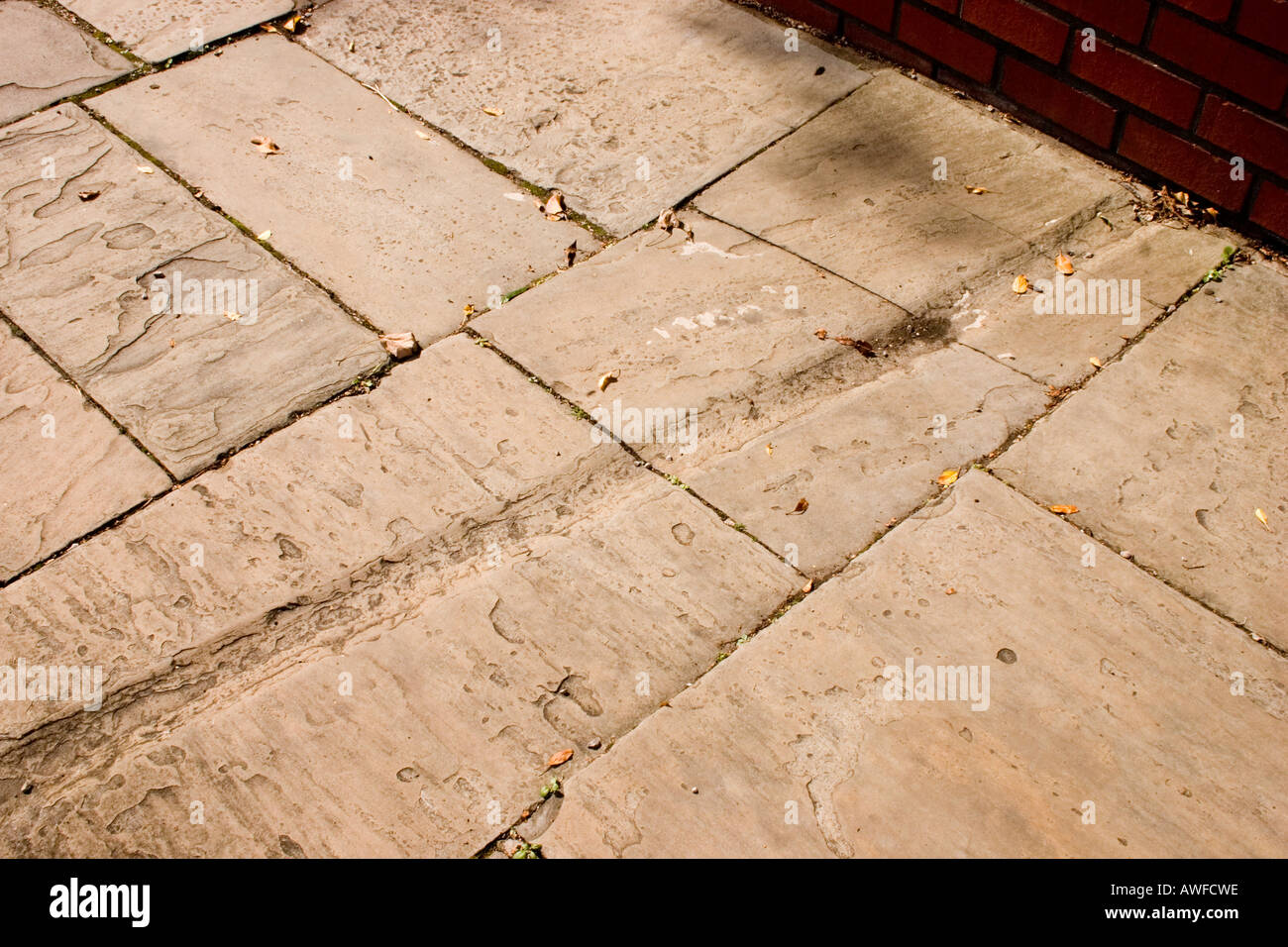 Rainwater channels for garden run off chiselled into Victorian Edwardian paving slabs Cardiff UK Stock Photo