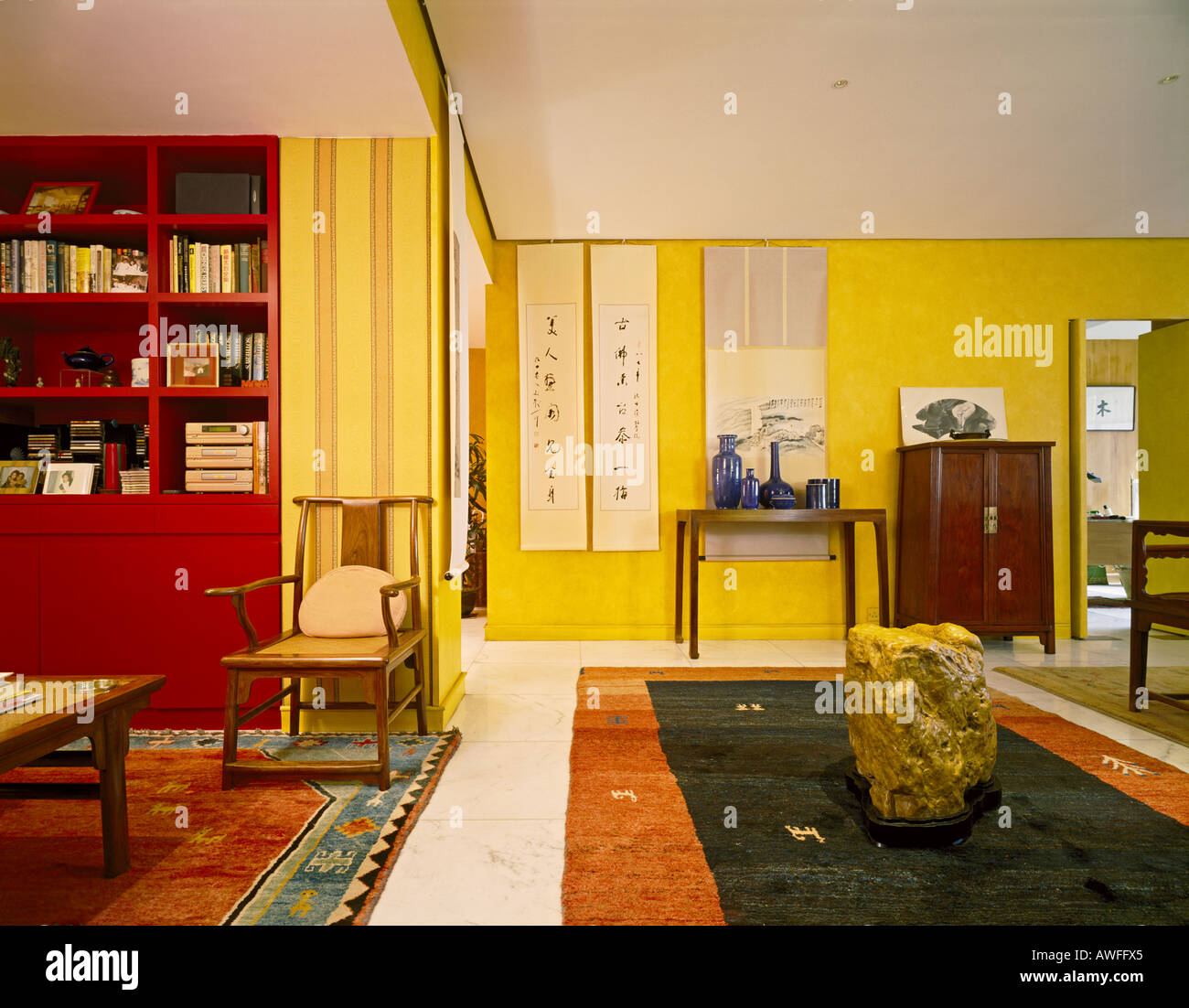 living room and rock stool in a modern chinese apartment with stockliving room and rock stool in a modern chinese apartment with distinct influence from the ming dynasty hong kong china