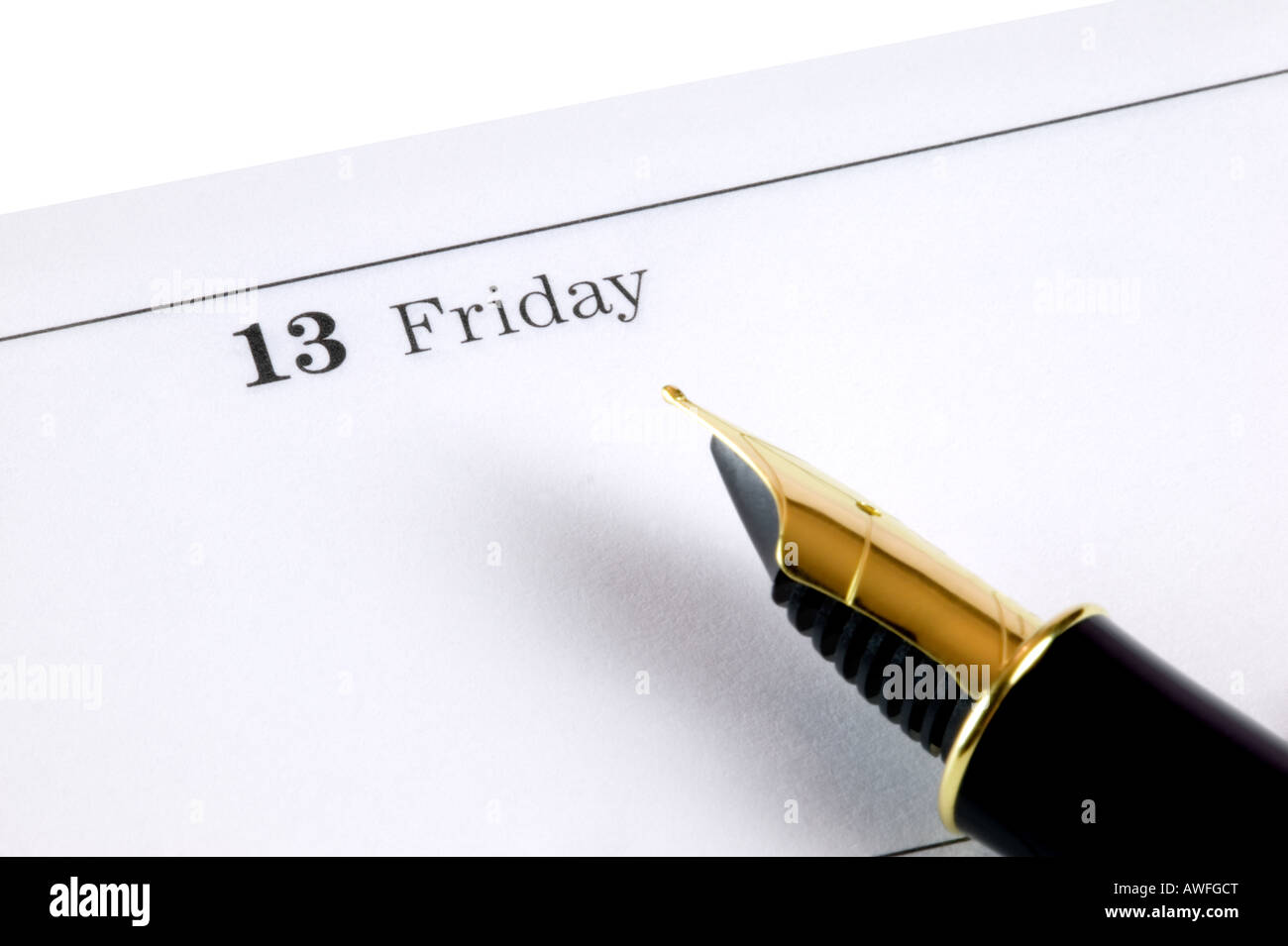 Friday 13th on a diary page with a gold nibbed fountain pen - Stock Image