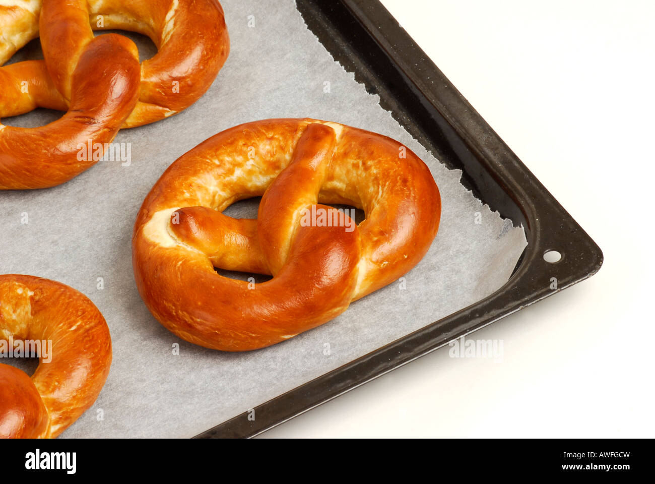 Pretzels on a baking sheet - Stock Image