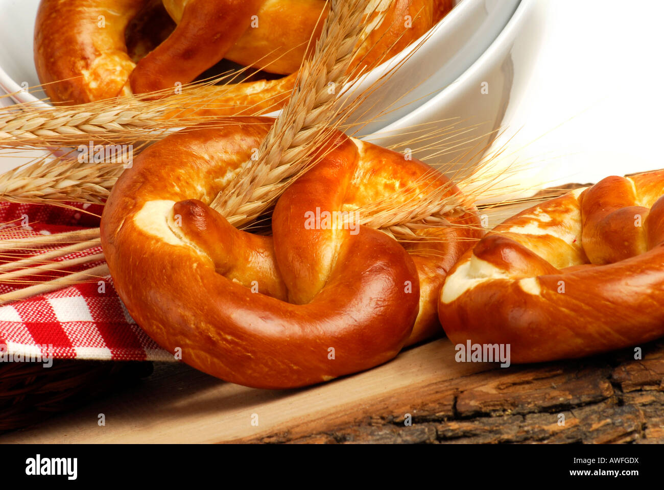 Lye pretzels and wheat spikes - Stock Image