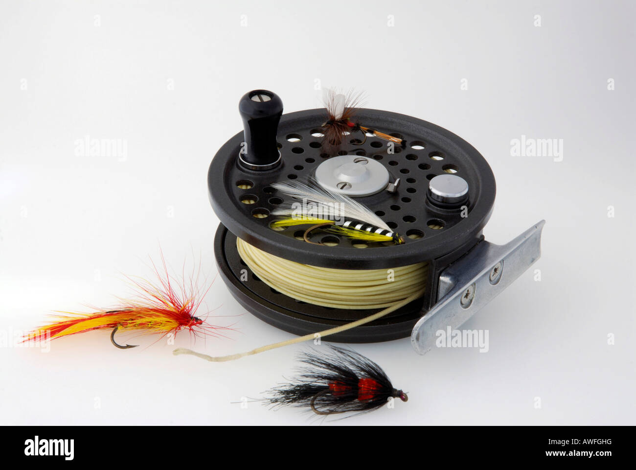 Fishing tackle: fishing reel with line and bait Stock Photo