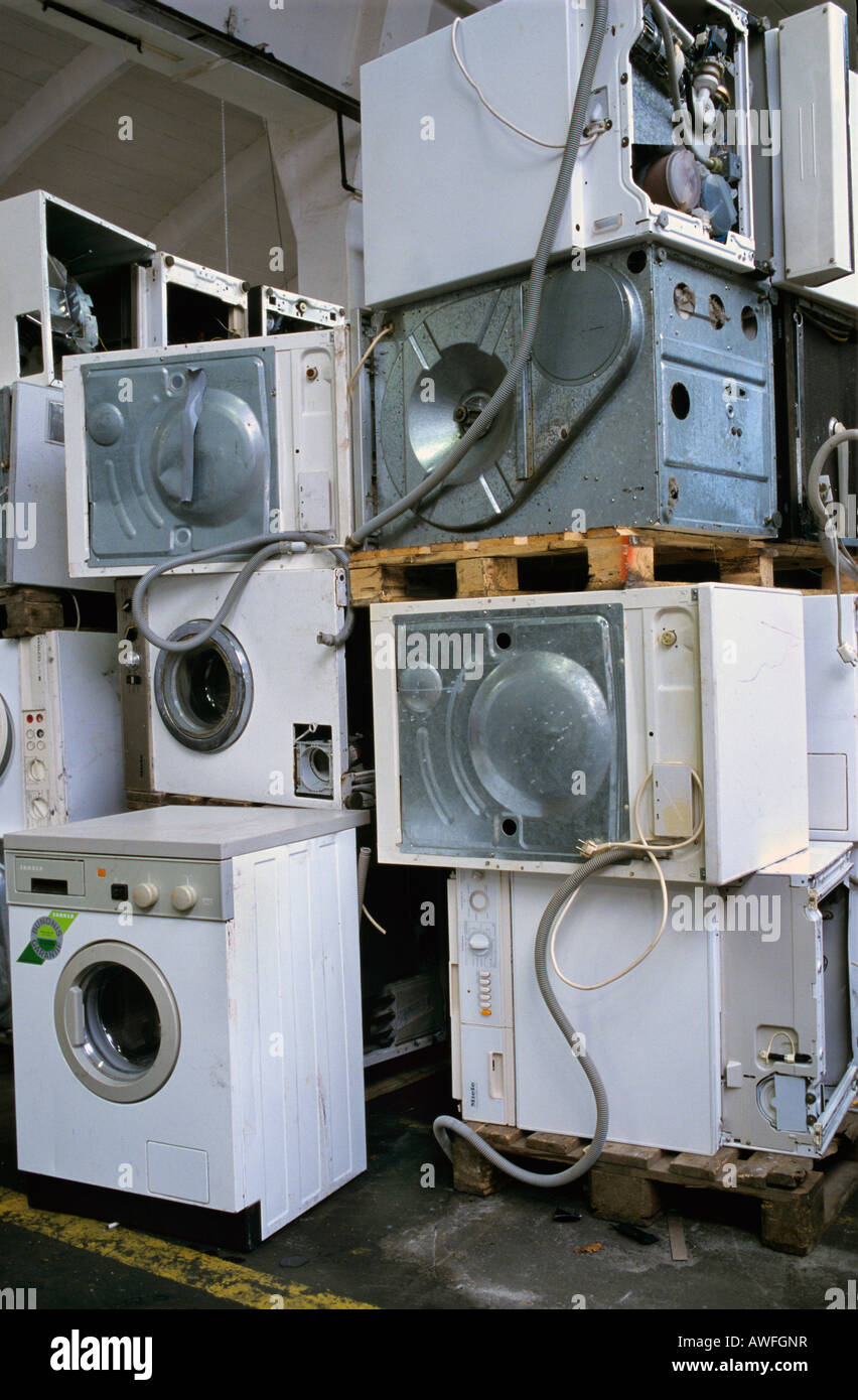 Washing machine disposal at a collection site for old washing machines - Stock Image