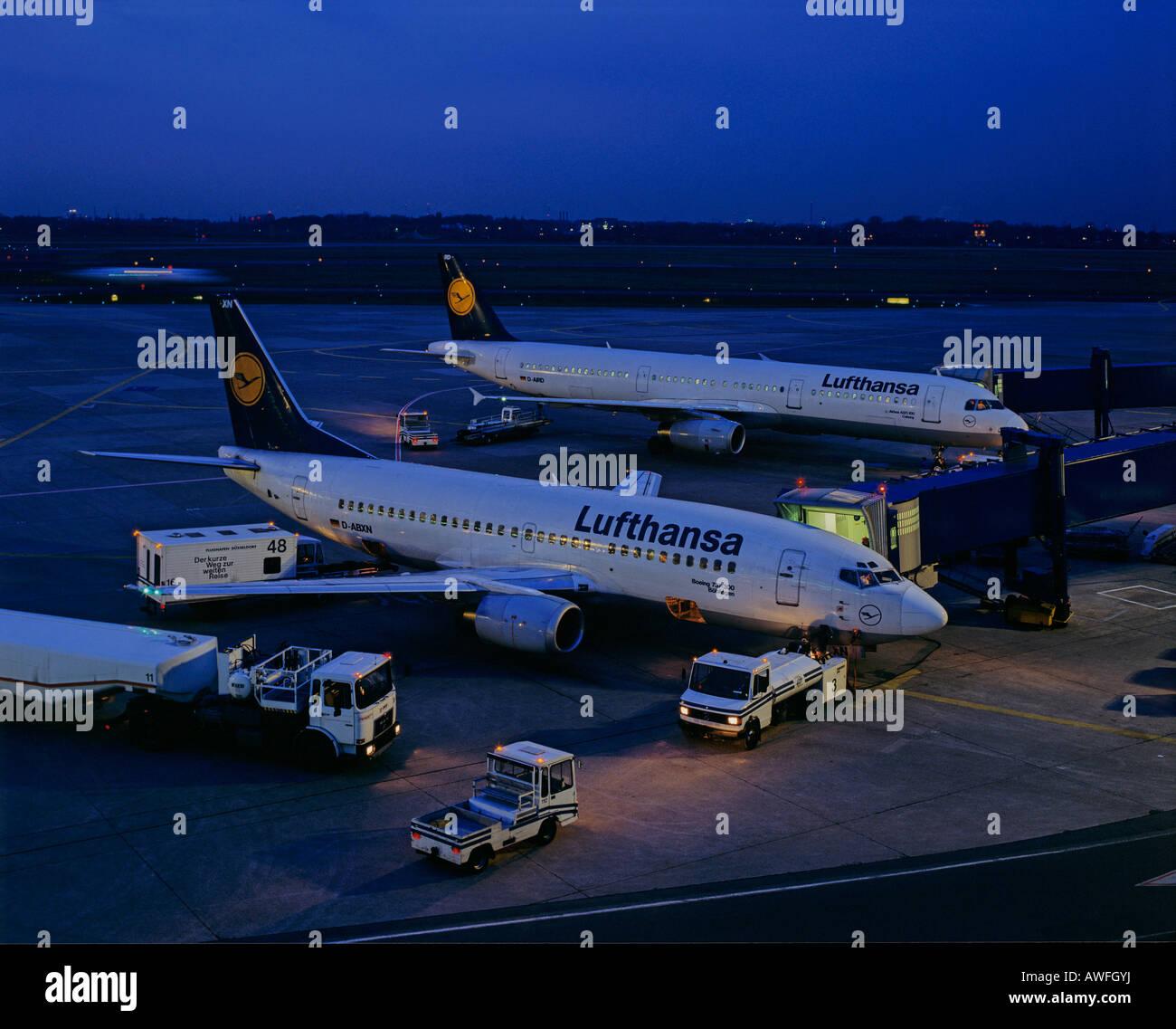Lufthansa airplanes being loaded at night, Frankfurt International Airport, Frankfurt, Hesse, Germany, Europe - Stock Image