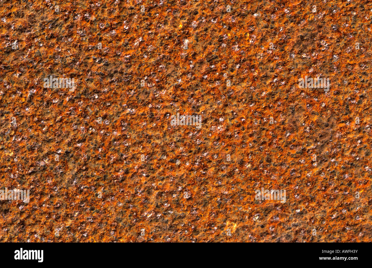 Rough-textured rust surface - Stock Image