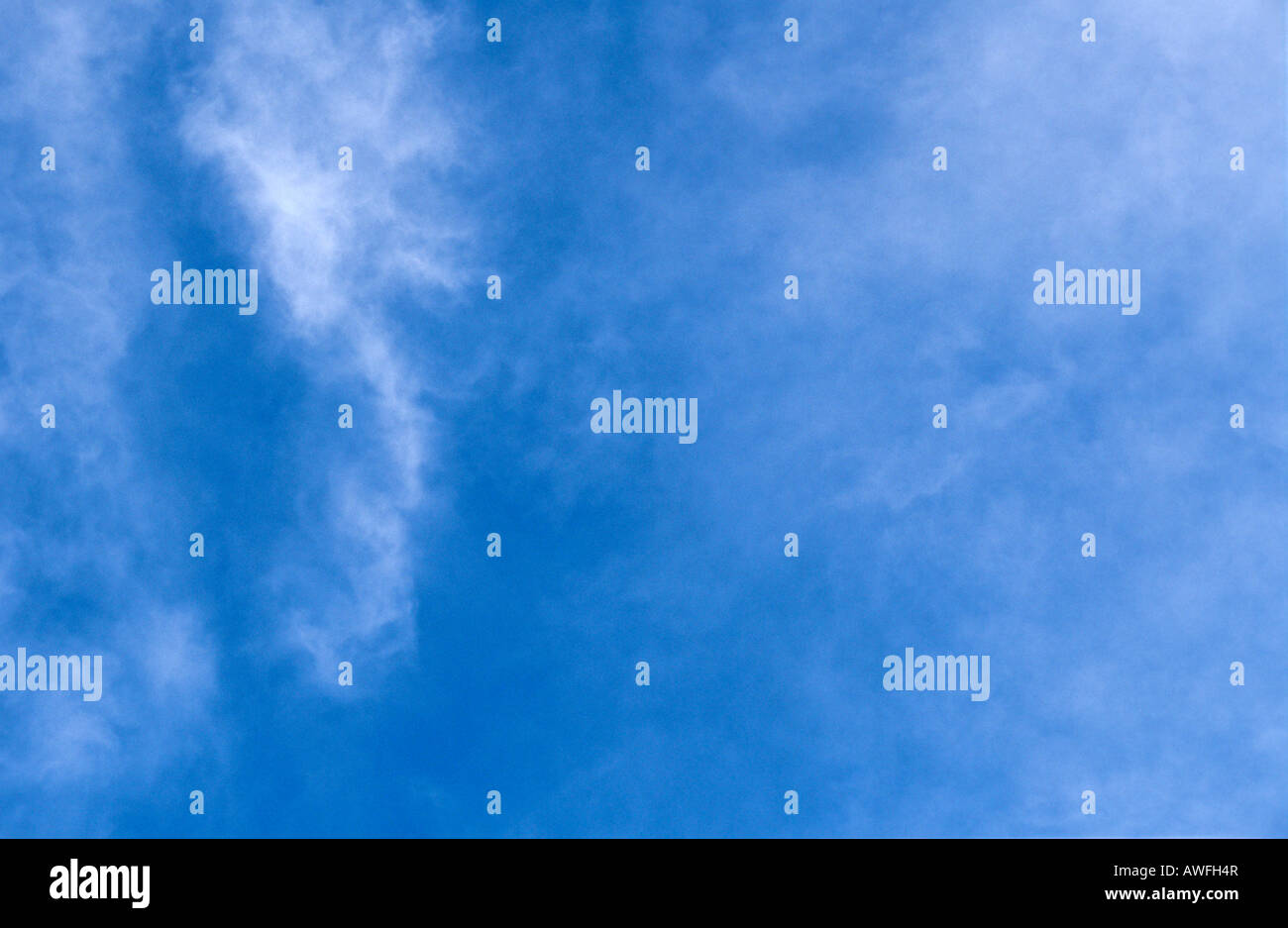 Cirrus clouds in a blue sky - Stock Image
