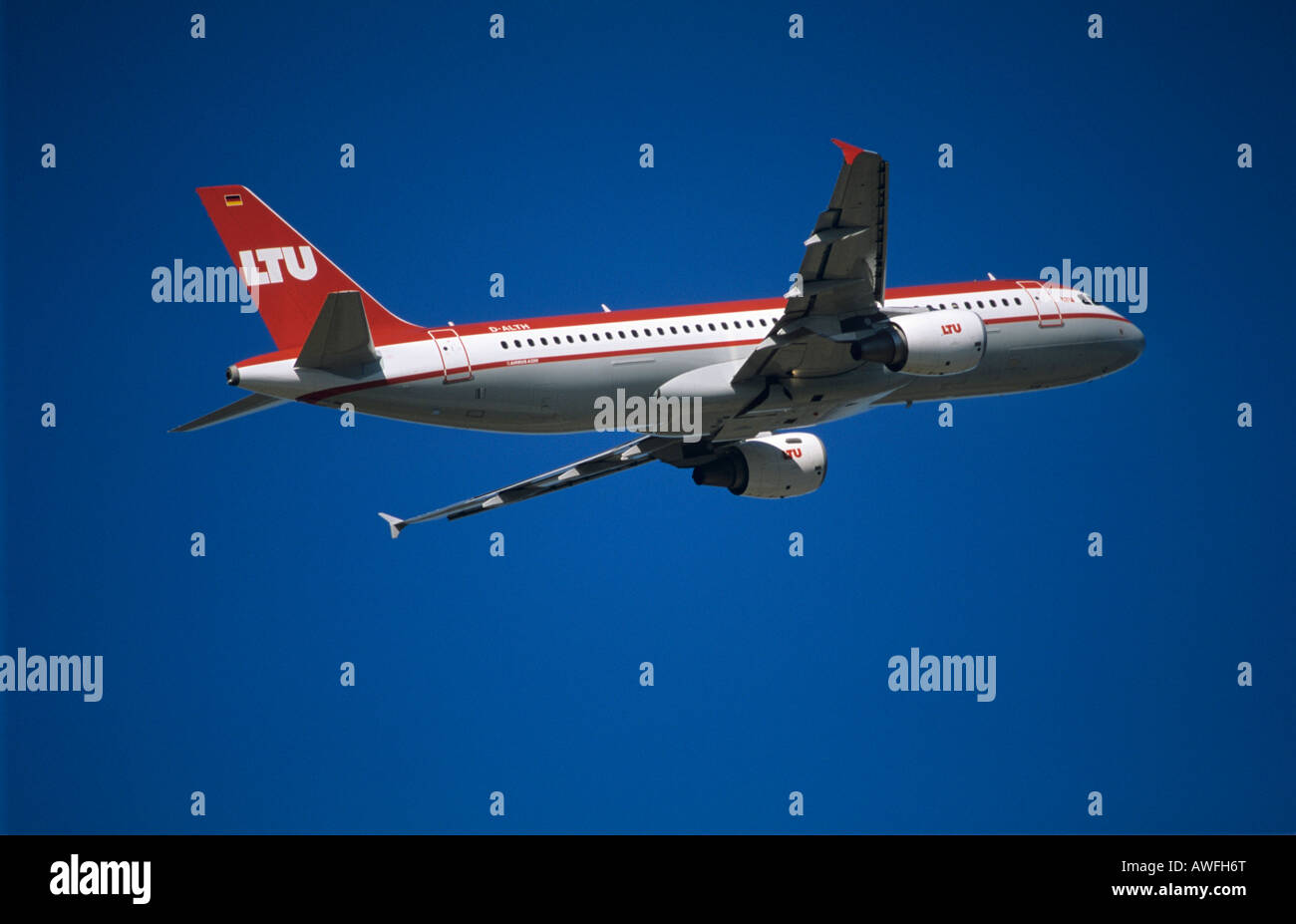 LTU airlines Airbus A320 shortly after take off, blue sky - Stock Image