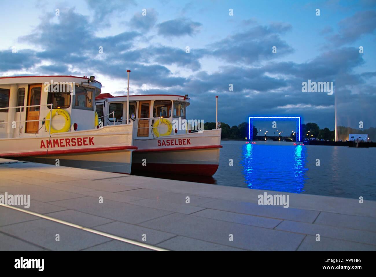 blue hour, sun down, sunset - Jungfernstieg with Alsterships Boats, Landmark of Hamburg, Germany, Europe - Stock Image