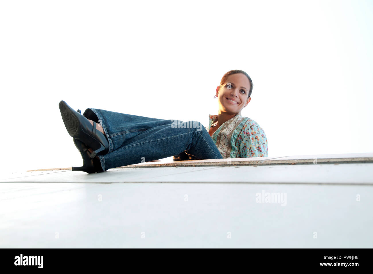 crazy girl on a wall - Stock Image