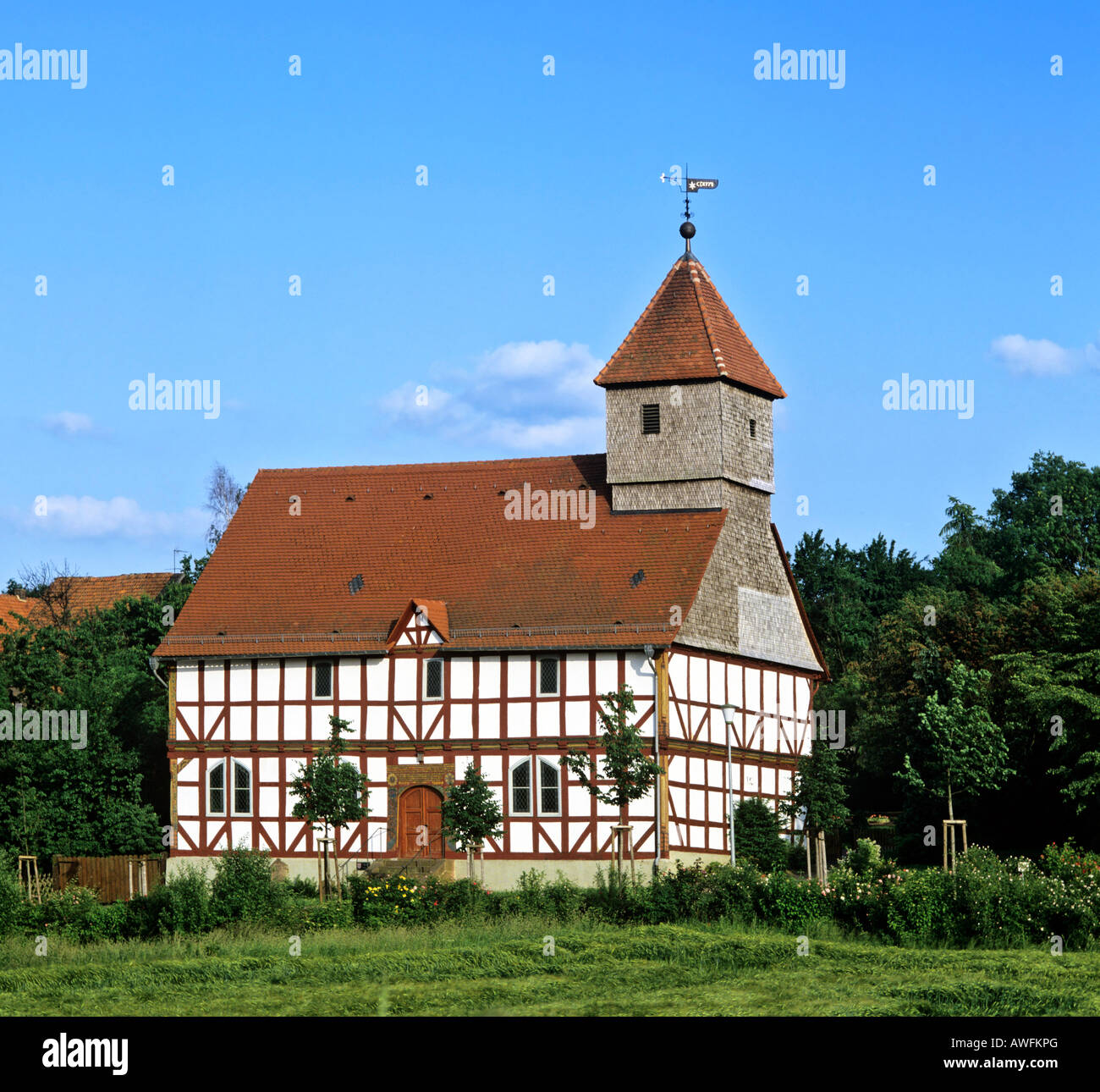 Fachwerk-style church dating to 1704 in Carlsdorf, Hesse, Germany, Europe - Stock Image