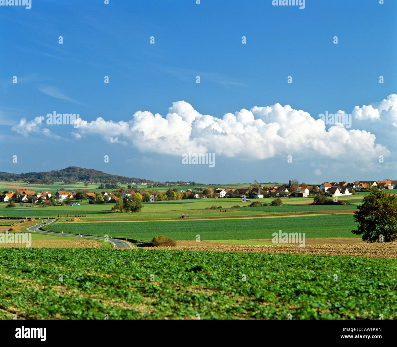 Panoramic view of clouds forming over the village of Udenhausen bei Grebenstein, Hesse, Germany, Europe - Stock Image
