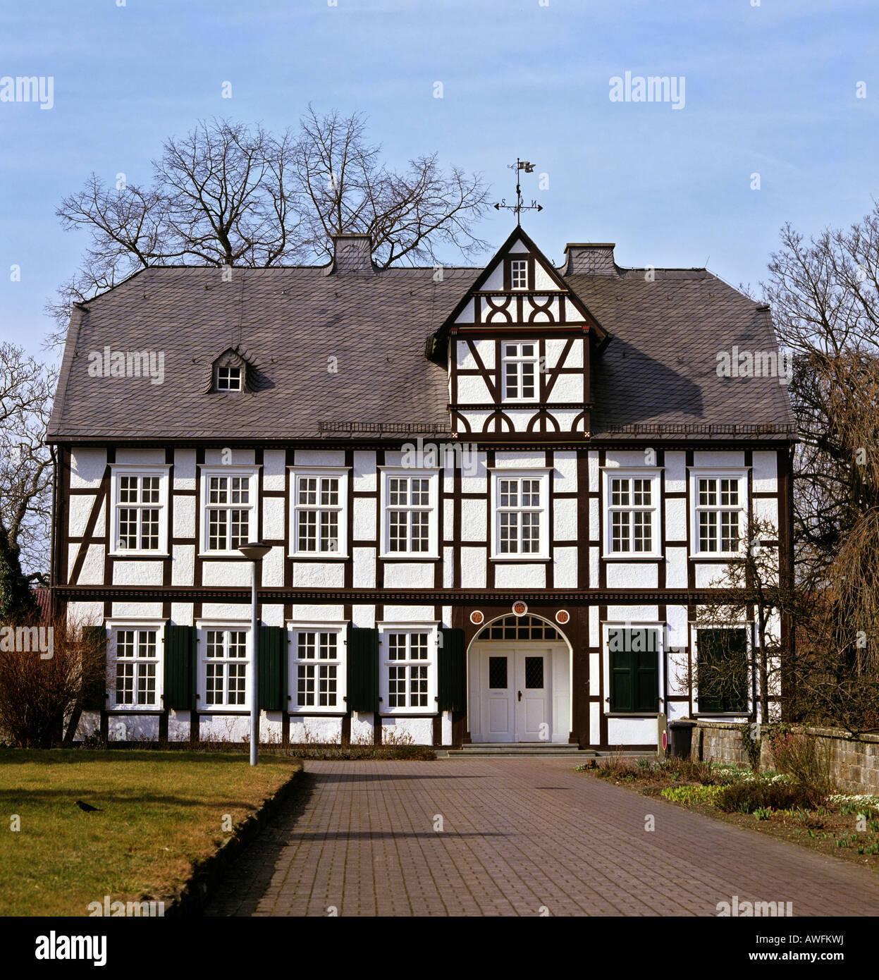 Fachwerk-style rectory in Anroechte, North Rhine-Westphalia, Germany, Europe - Stock Image
