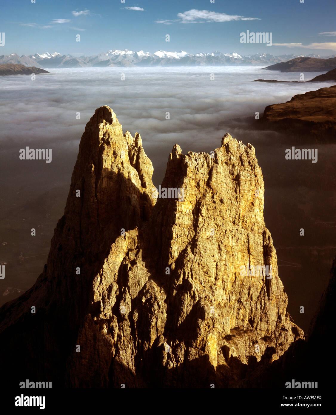 Mt. Santnerspitze and Mt. Euringerspitze, Euringer Turm, Schlern Massif, Eisacktal Valley in a sea of fog, Dolomites, - Stock Image