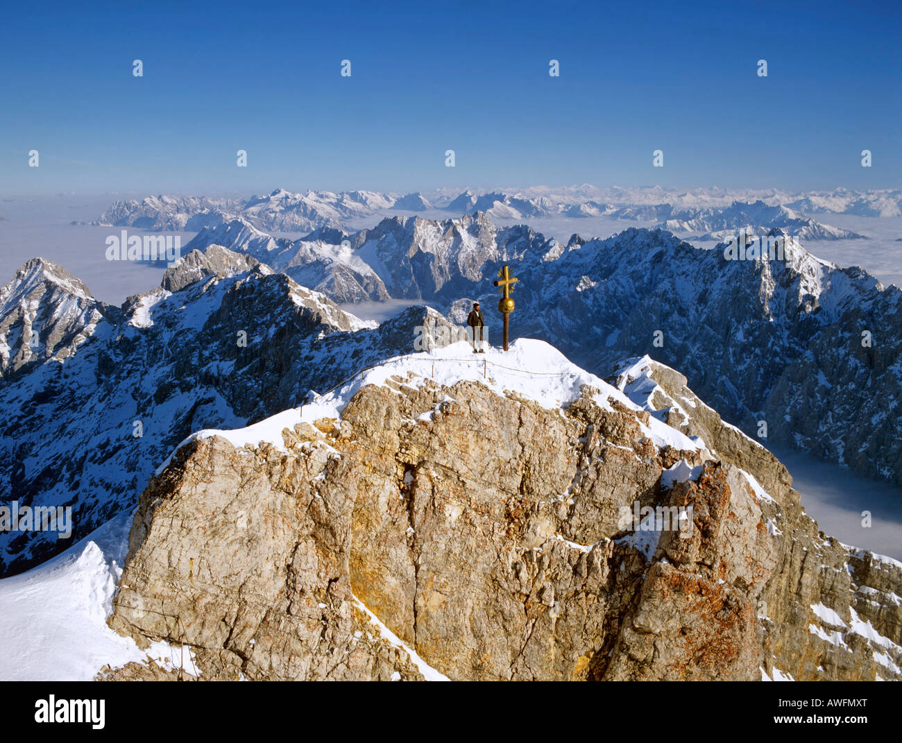 Panoramic view of the summit cross on Mt. Zugspitze, Wetterstein Range, Upper Bavaria, Bavaria, Germany, Europe - Stock Image
