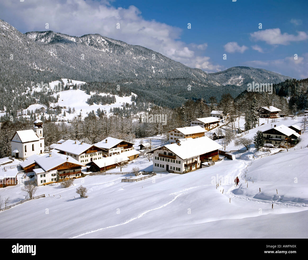 Farmhouses in the town of Wamberg with the Ester Range in the background, wintertime, Upper Bavaria, Bavaria, Germany, - Stock Image