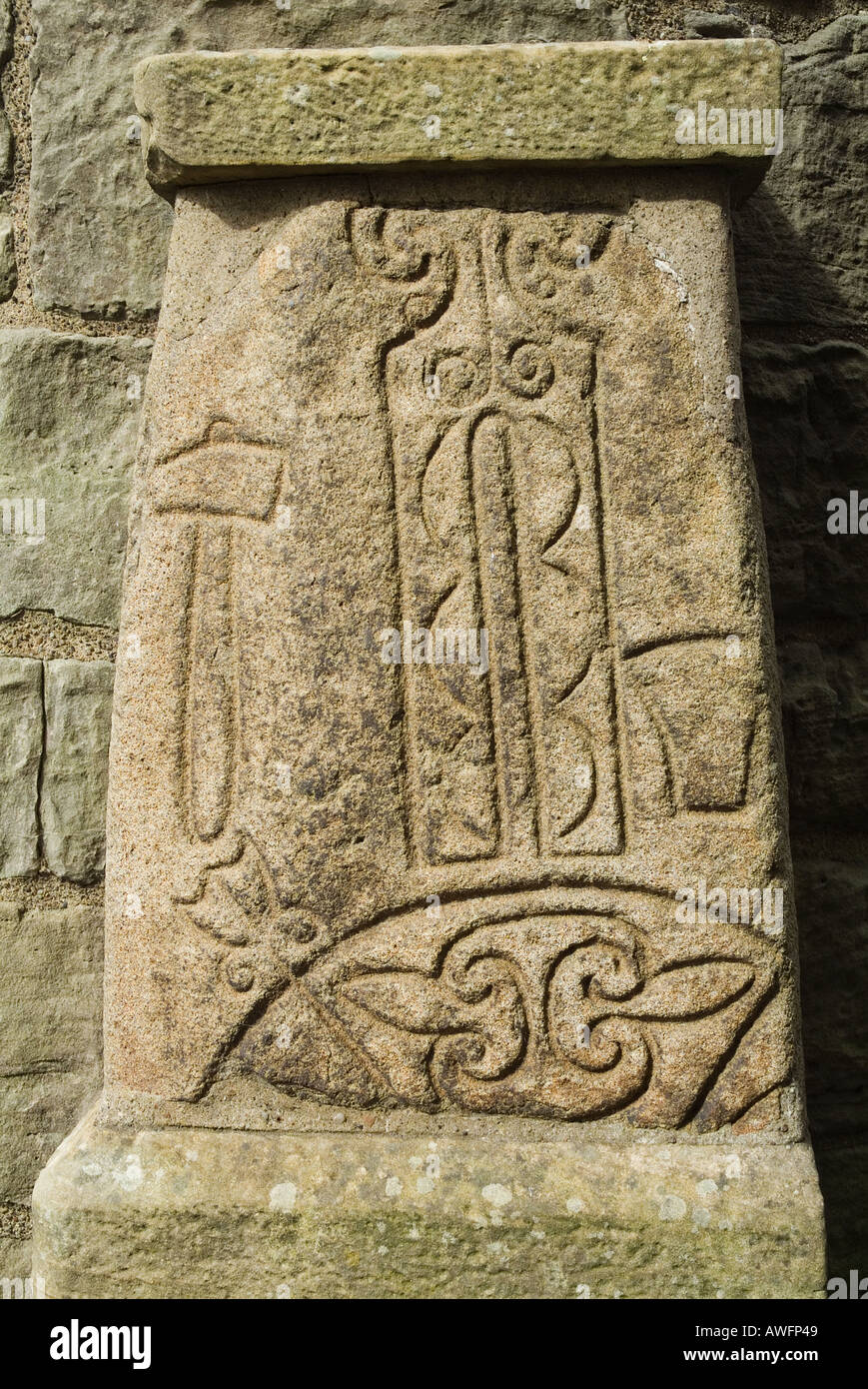 dh Pictish art carving ABERNETHY PERTHSHIRE SCOTLAND On stone at foot of 11st century Irish celtic round tower pict symbol Stock Photo