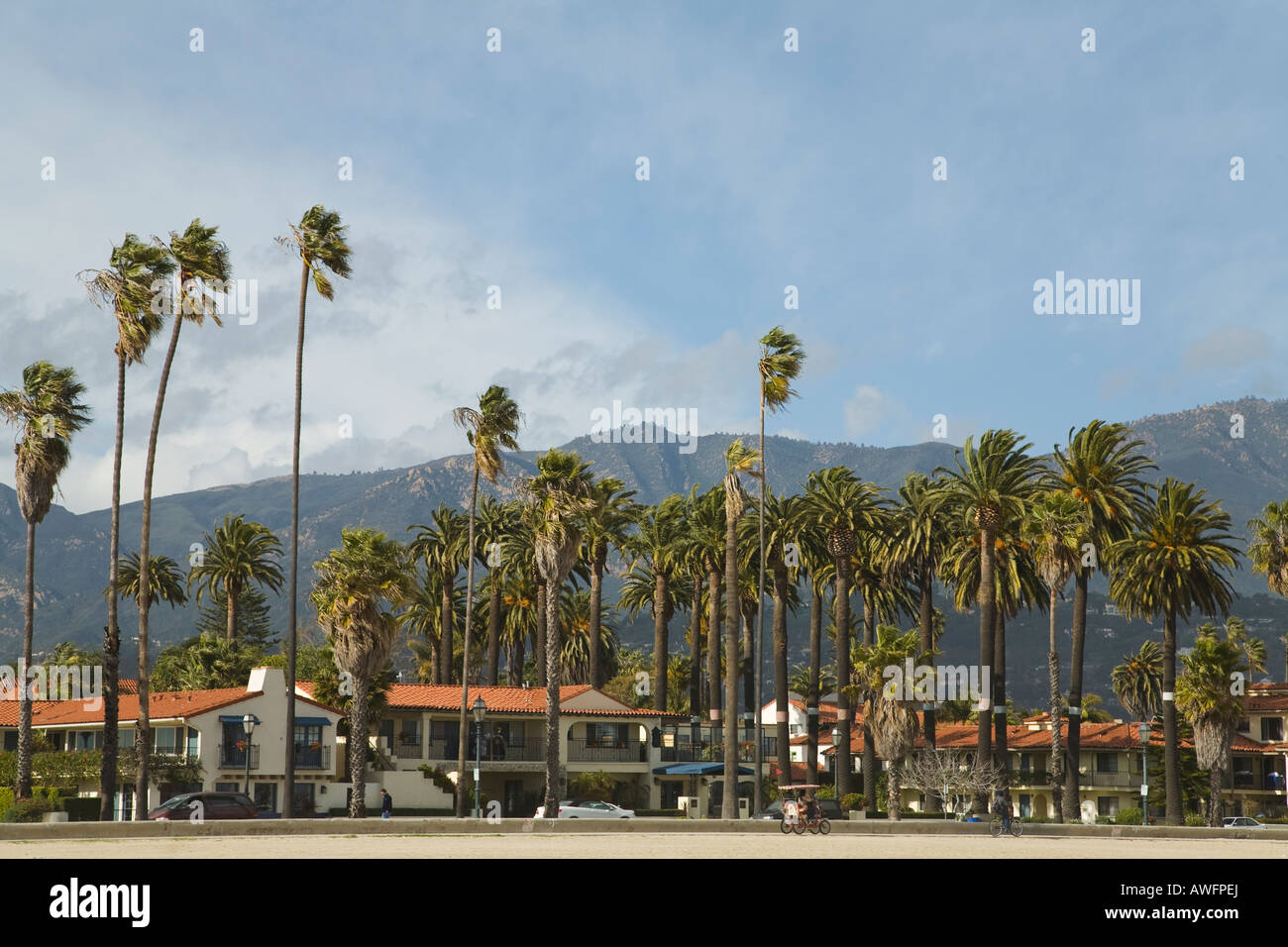 CALIFORNIA Santa Barbara Hotels along Cabrillo Boulevard palm trees red tile roofs across street from beach and - Stock Image
