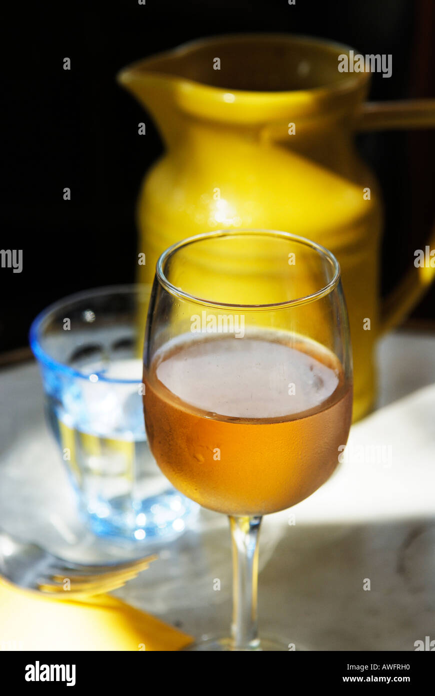 Vin Gris and yellow water Carafe - Stock Image