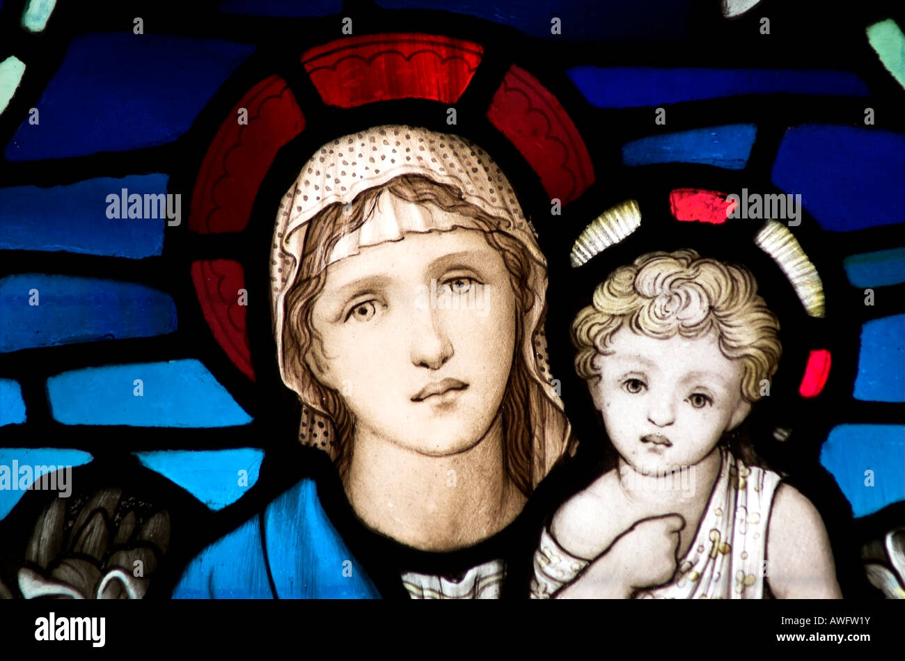 A stained glass window of madonna and child Mary and baby Jesus - Stock Image