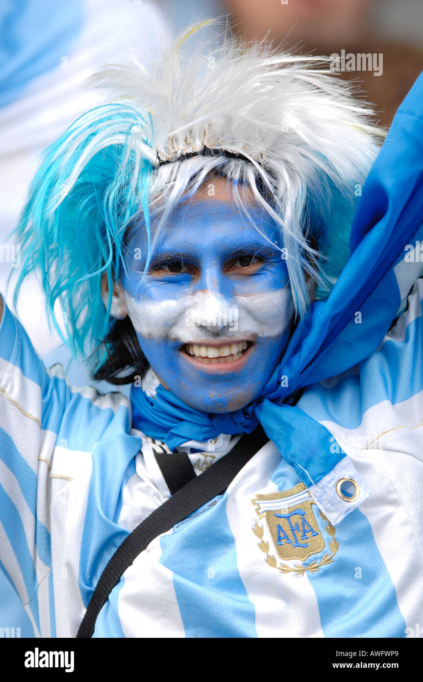Supporter of the national Football team of Argentina has painted his face in the colors blue and white - Stock Image
