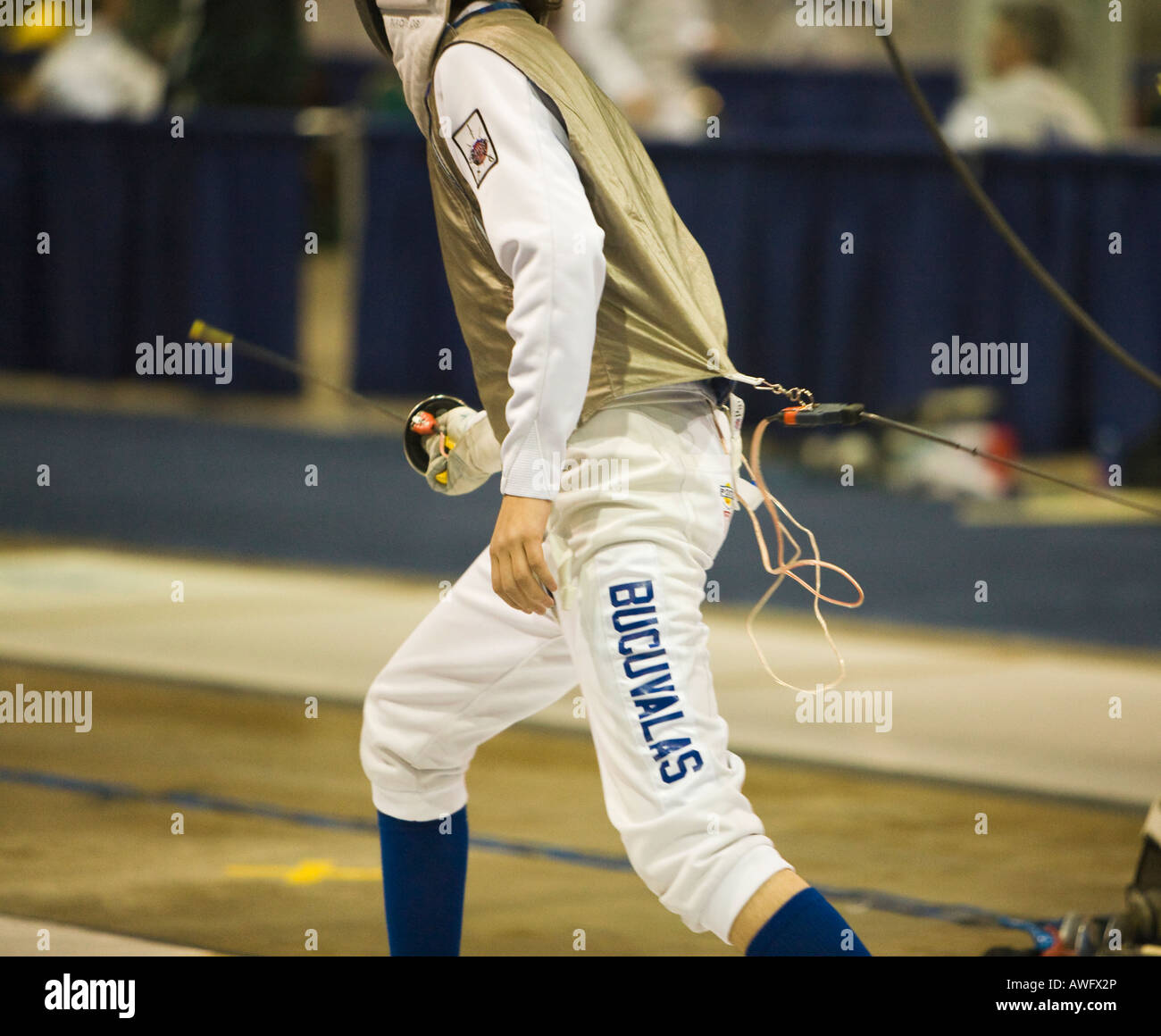 SPORTS Fencing competition bout male foil competitor on strip during match electronic connector to lame name stencil - Stock Image