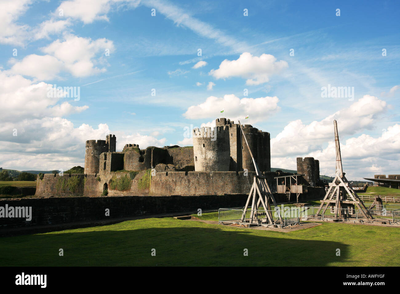 The grounds of Caerphilly Castle with ancient medieval ruins and wooden siege engines Glamorganshire South Wales UK - Stock Image