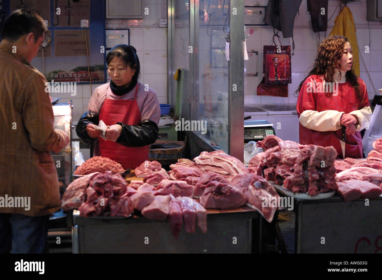 A vendor sells pork at her stall in a free market in Beijing China. 12 Mar 2008 - Stock Image