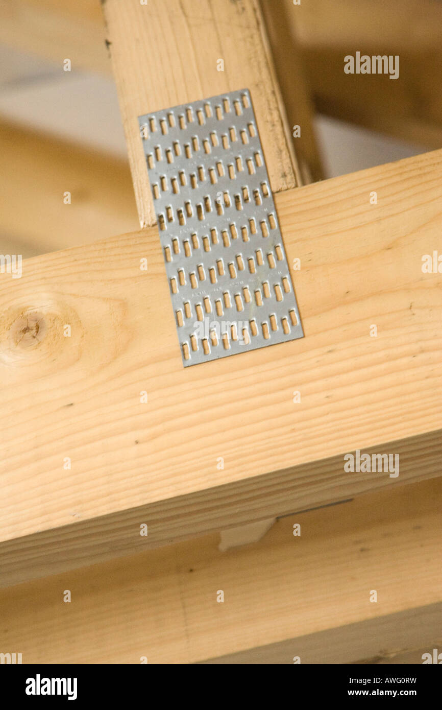 gang-nail plate holding timber beams together in a timber roof Stock ...