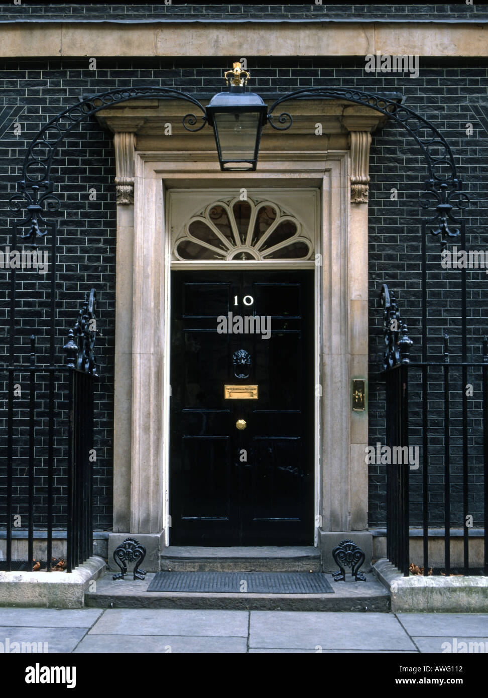 Britain's most famous front door 10 downing street. Ten Downing St is the London home of the prime minister of the United Kingdom. Famous front door. - Stock Image