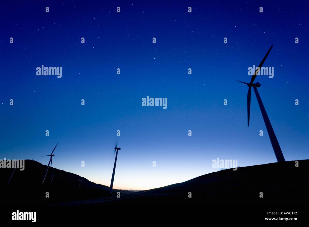 Windmills at dawn in Te Apiti Wind Farm, Palmerston North, Manawatu, North Island, New Zealand - Stock Image