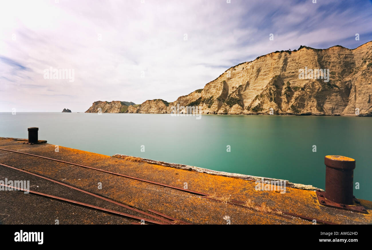 Tolaga Bay Wharf and headland North Island New Zealand - Stock Image